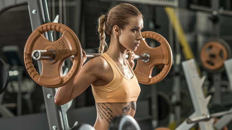 Dimagrire e tonificare in palestra con i pesi?